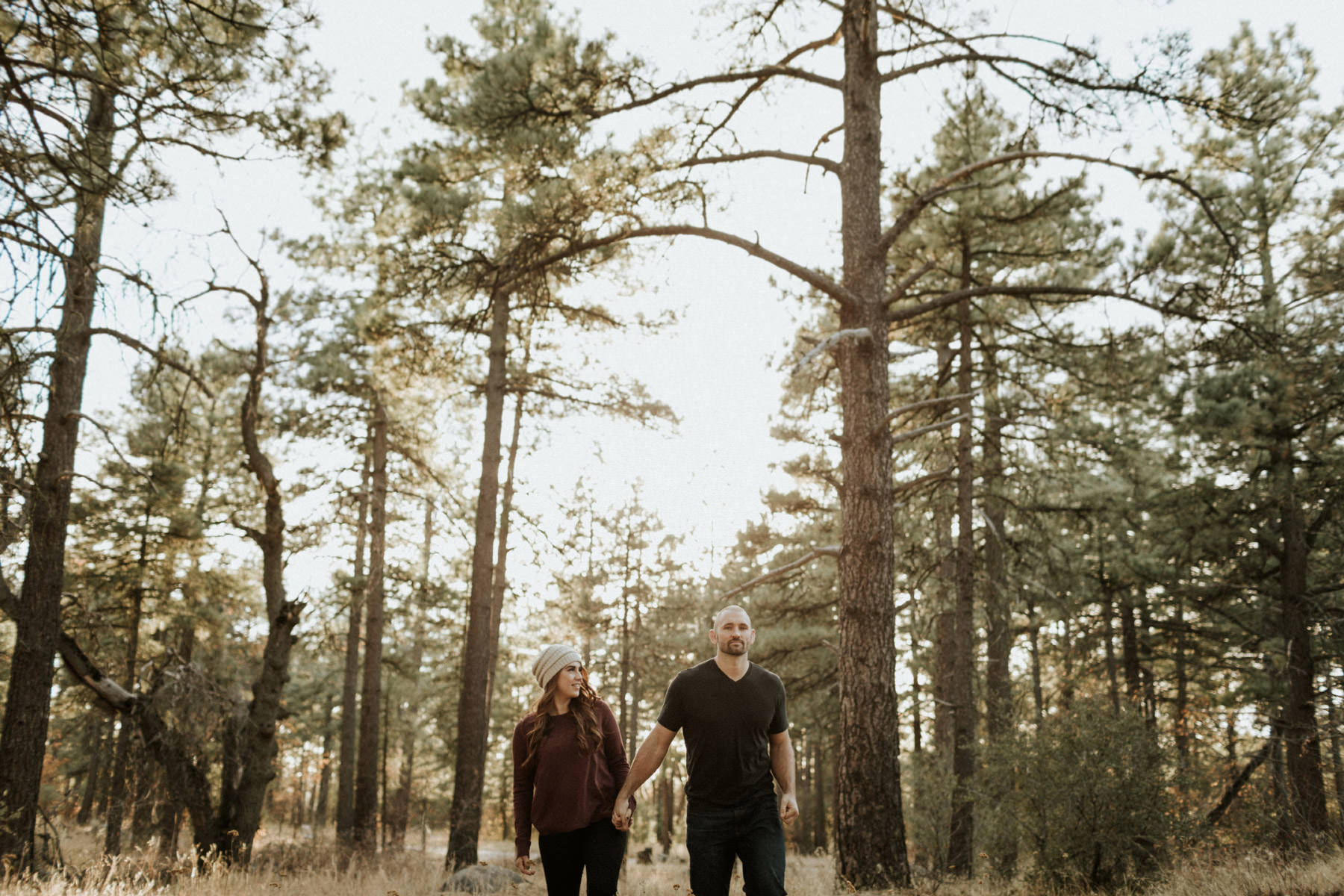 Couple walking through the woods of Mount Laguna