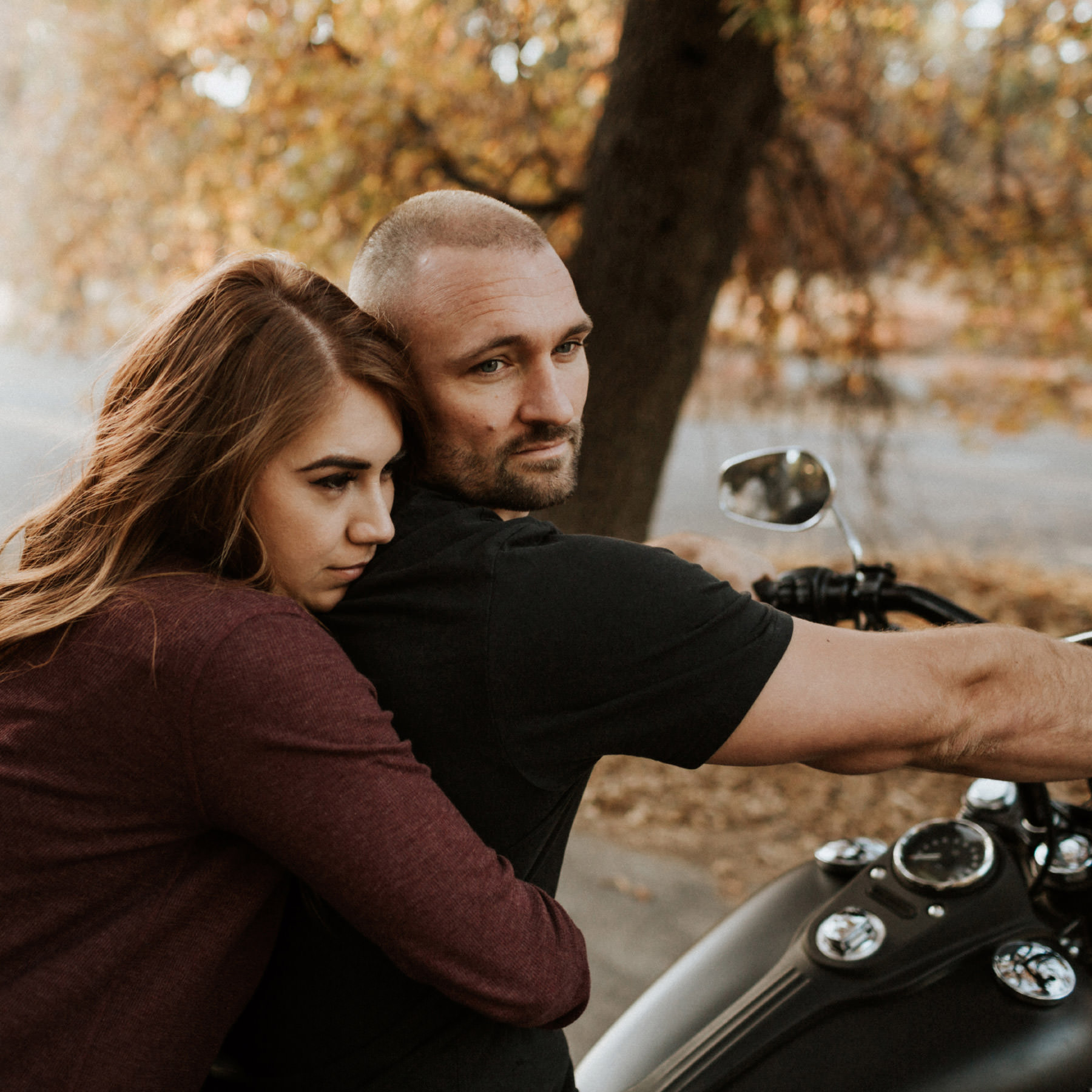 Fall motorcyle couple