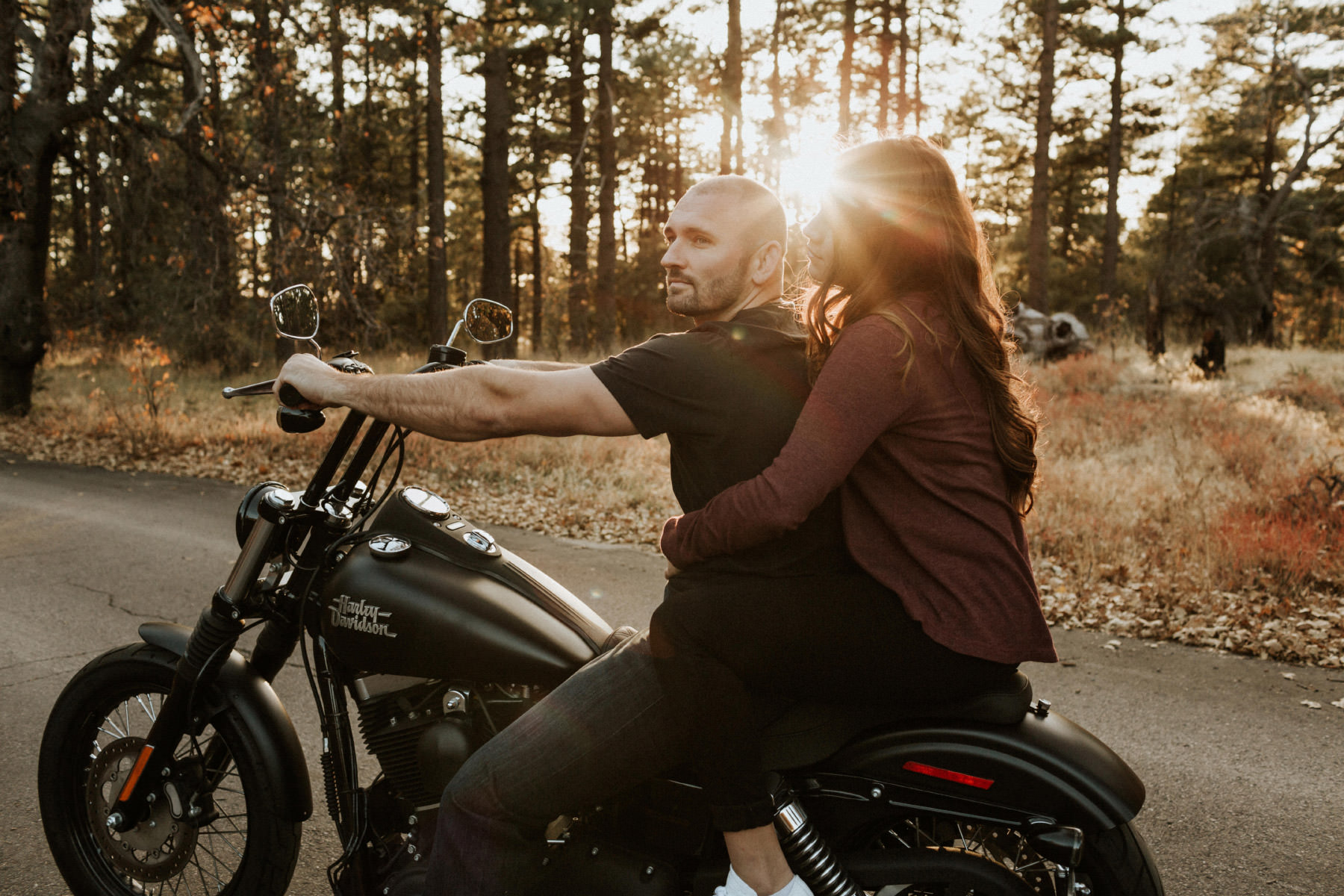 Motorcycle couple in the forest