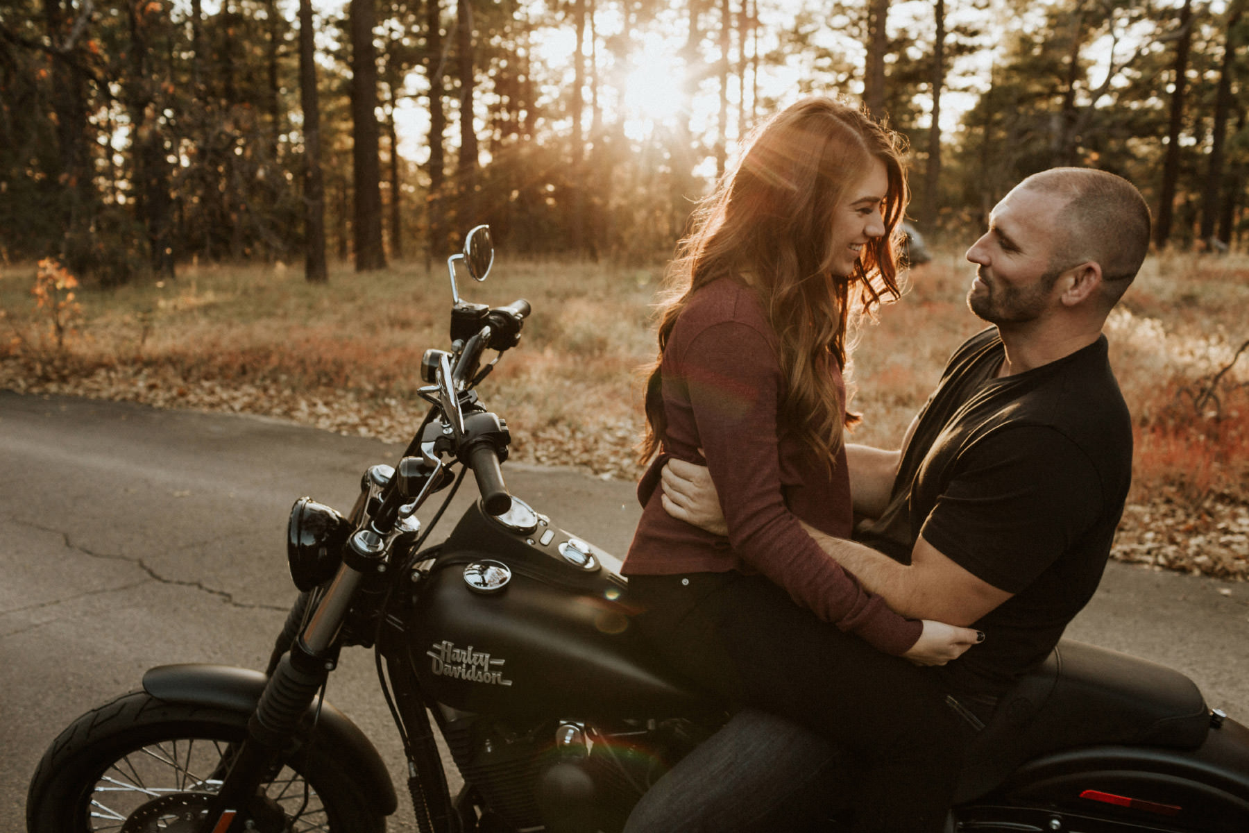 Couple stradling on a motorcycle