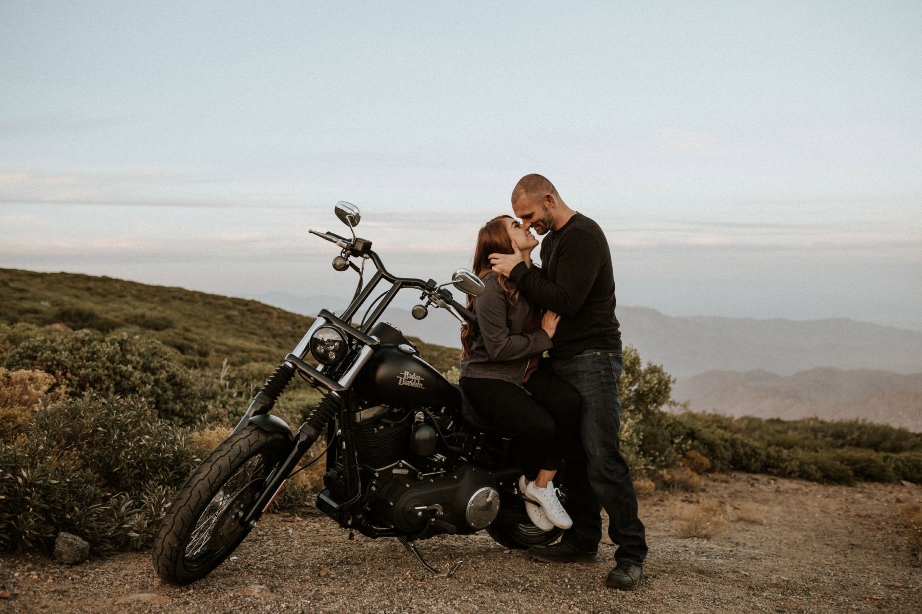 Mountain motorcycle couple kissing
